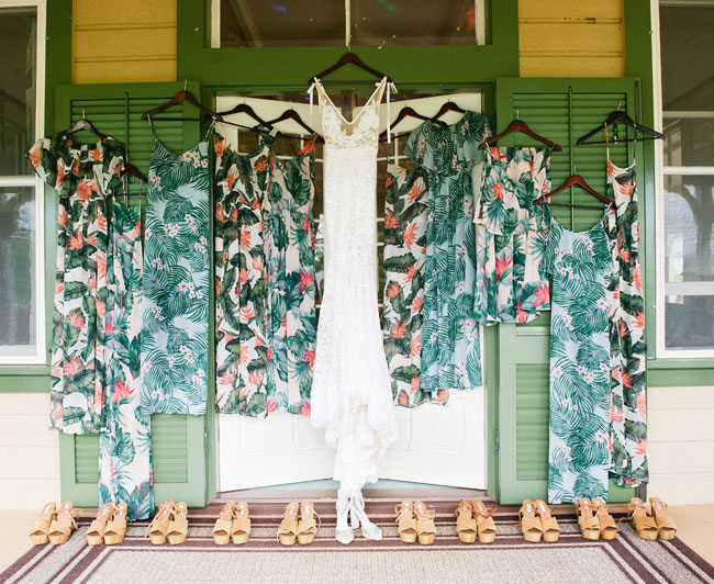 Wedding dress with Bohemian floral bridesmaid dresses and sandals.