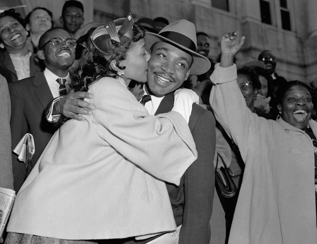 martin-luther-king-jr.-is-welcomed-with-a-kiss-by-his-wife-coretta-after-leaving-court-in-montgomery