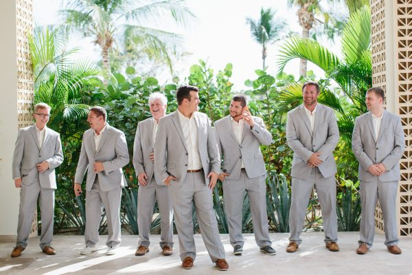 Grey suit wedding day attire inspiration for groomsmen.
